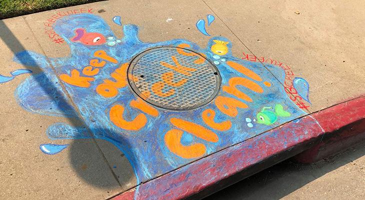 Storm Drain Chalk Art featuring words