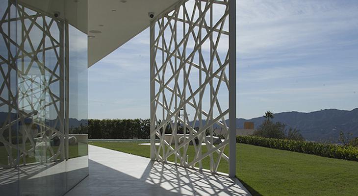 Clocks and Clouds: The Architecture of Escher GuneWardena
