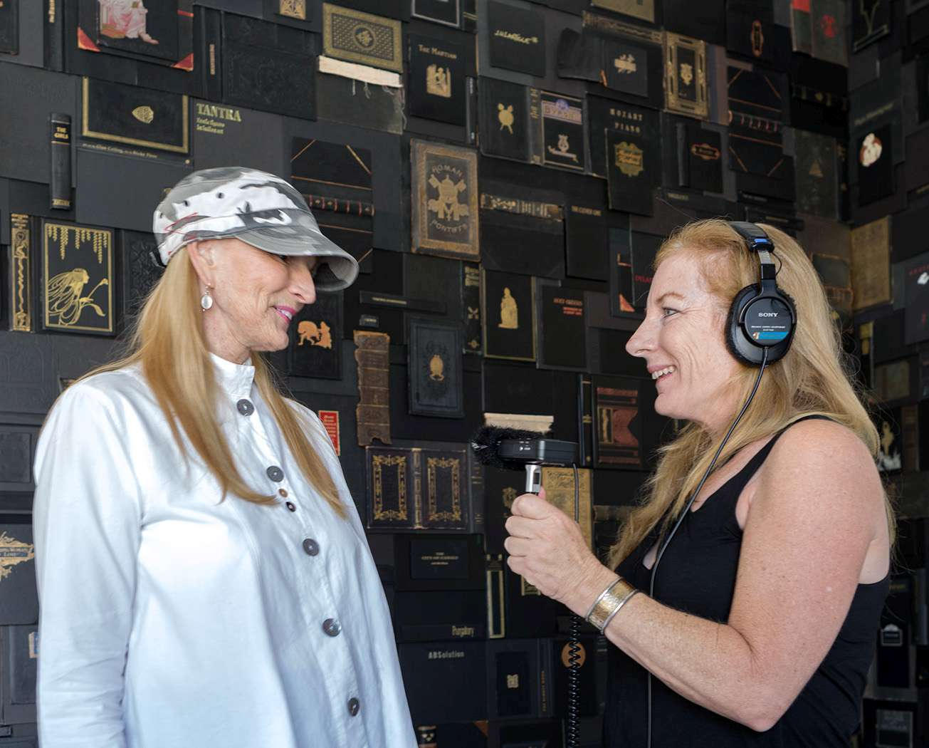 Lisa Osborn (r) interviews artist Nancy Gifford in front of Gifford's work, Lament, for a Lisa.FM podcast episode.  title=