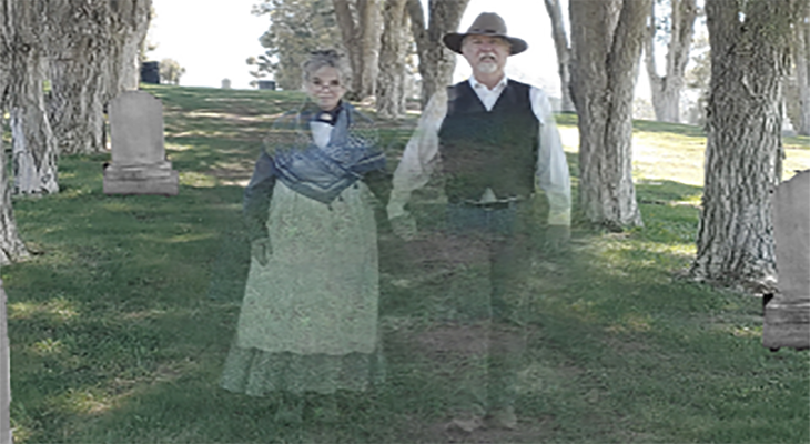 Ghostly image of two local actors portraying historic Santa Barbara community members at Goleta Cemetery title=
