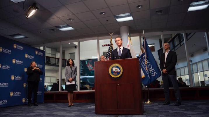 Newsom lays out four-phase reopening, hints at earlier school start date