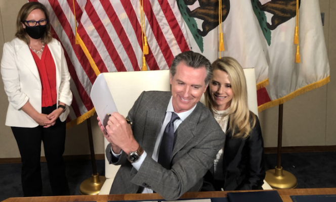 Governor Newsom signs bill extending job-protected family leave alongside First Partner Jennifer Siebel Newsom and Chief of Staff Ann O'Leary (courtesy photo) title=