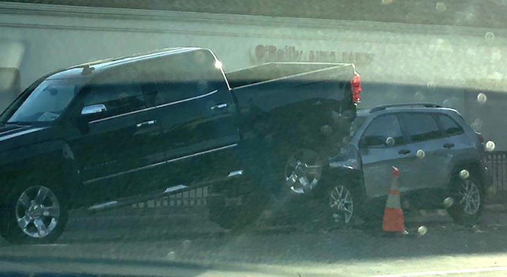 SUV Crashes Under Truck on Milpas title=
