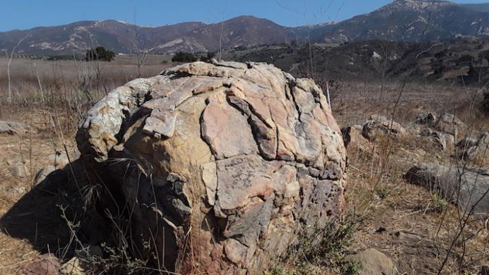 Weathered boulder sits atop San Antonio Alluvial Fan, San Marcos Foothills (Photo: Susan Bartz) title=