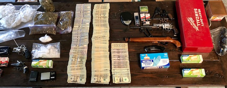 Alleged Gang Member Arrested with Drugs and Guns title=