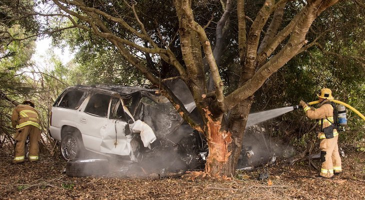 Car Catches Fire After Crashing into Tree on Storke Offramp title=