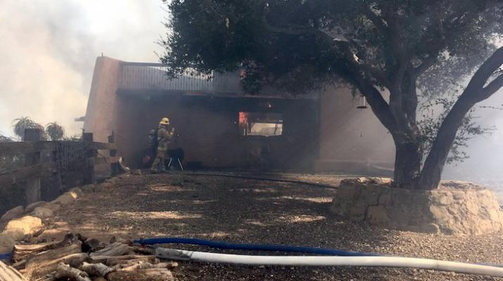 Structure Fire on Refugio Spreads to Brush title=