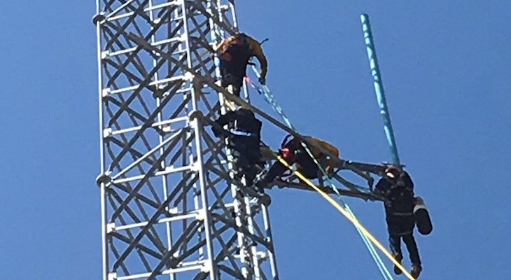 Firefighters Rescue Man Stuck on Radio Tower title=