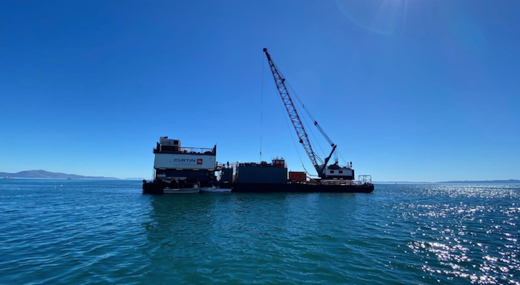 Barge Off East Beach Assisting with Desalination Equipment title=