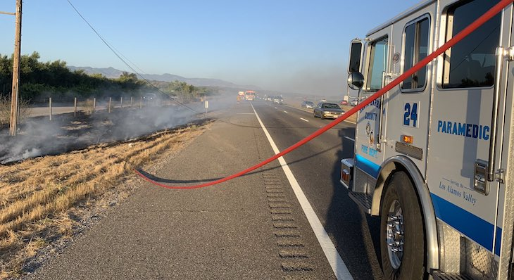 Rollover Traffic Collision Starts Brush Fire in Los Alamos