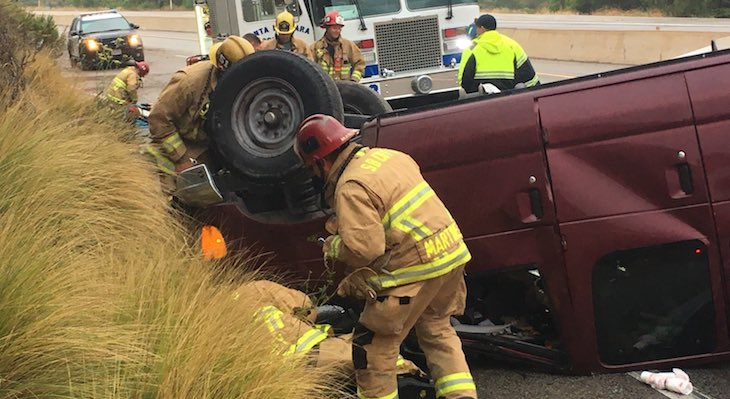Man Trapped in Rollover Vehicle Crash title=