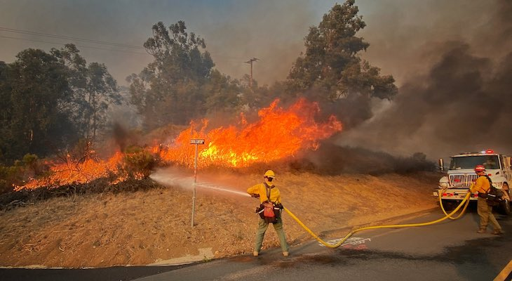 Firefighters working on a roadside fire off Calle Real near Refugio Rd on Tuesday (Photo: Mike Eliason / SBCFD)