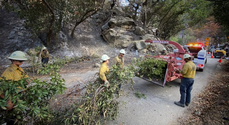 SBC Crew work to remove trees on Refugio Rd that have fallen in the fire as well those that pose a threat to falling on the roadway. Also, a SBC engine surveys the scene of the charred landscape along Refugio Rd. (Photo: Mike Eliason)