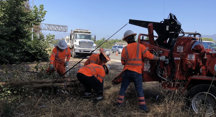 Caltrans crews conducting vegetation removal for fire prevention on Highway 101 in the City of Goleta at Fairview