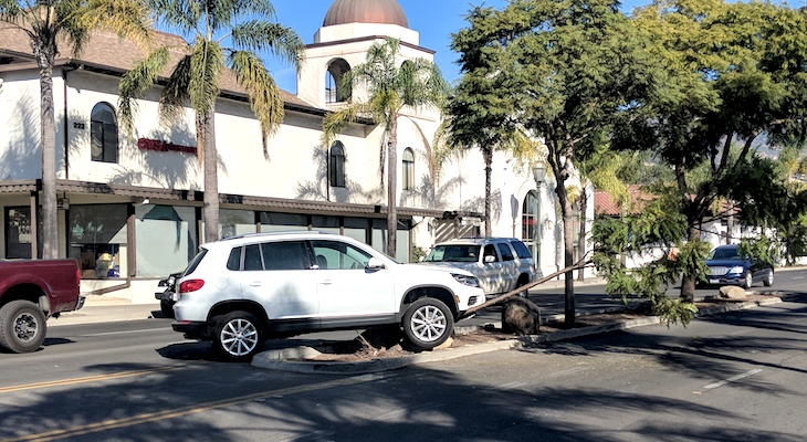 SUV Crashes into Boulder on Carrillo title=