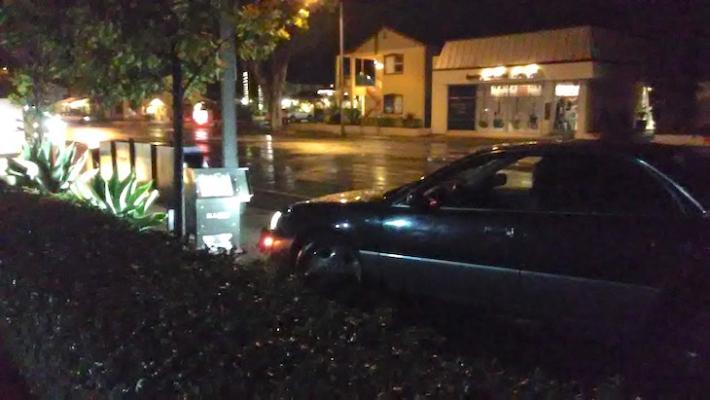 Car Crashes into Newspaper Boxes on State Street