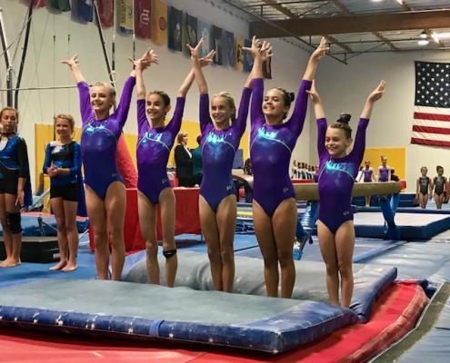 Spirals Gymnasts Soar in Season Openers