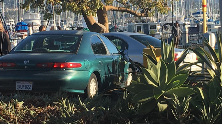 Vehicle Crashes In Harbor Parking Lot