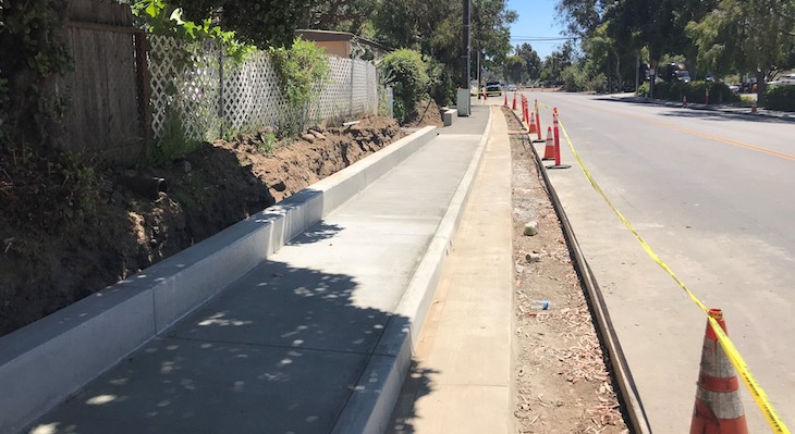 Photos of the newly constructed sidewalk and retaining curbs on the east side of Pine Avenue.