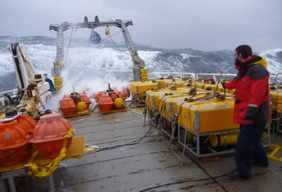 Ocean-bottom seismometers aboard the R/V Welcoma were deployed in the first year of the Cascadia Initiative. Photo credit: Dave O'Gorman title=