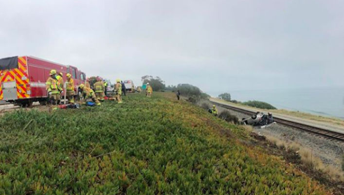 Vehicle Crashes Over Highway 101 onto Railroad Tracks title=