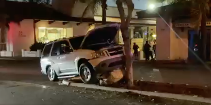 Vehicle Crashes into Center Divider