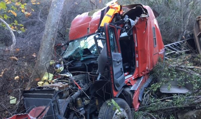 Semi-Truck Crashes Over Side of SR-154 title=