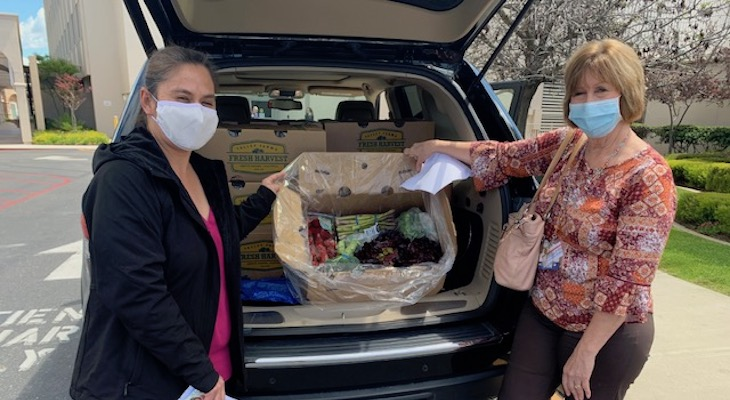 Marian Medical Staff Deliver Produce to Pediatric Families title=