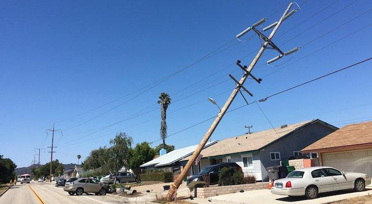 Vehicle Collides with Power Pole Causing Widespread Outage