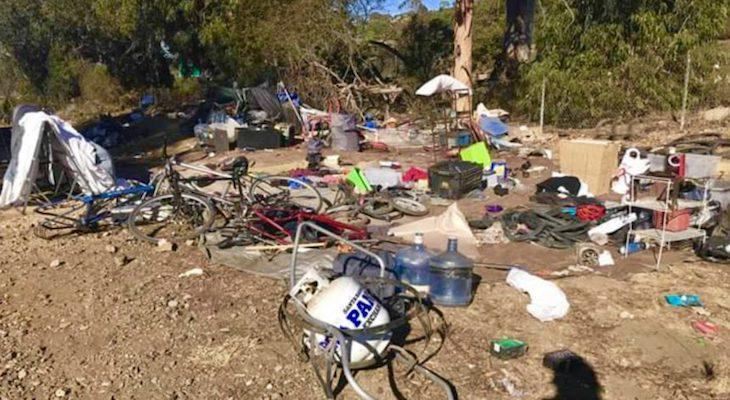Homeless Camp Cleared Near Railroad Tracks