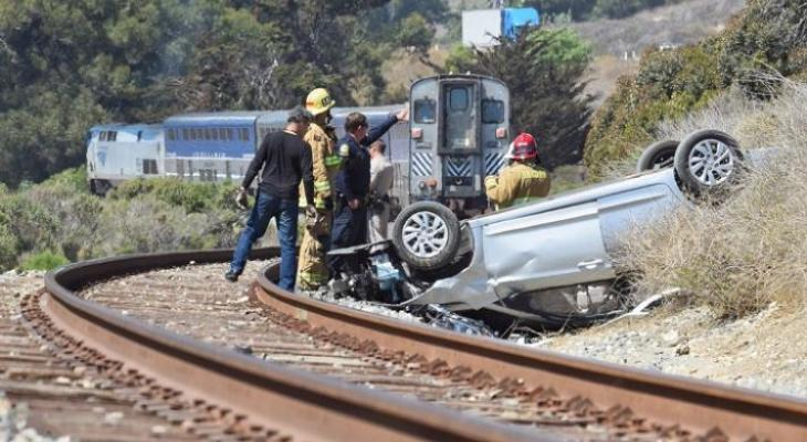 Couple Uninjured After Vehicle Is Hit By Train