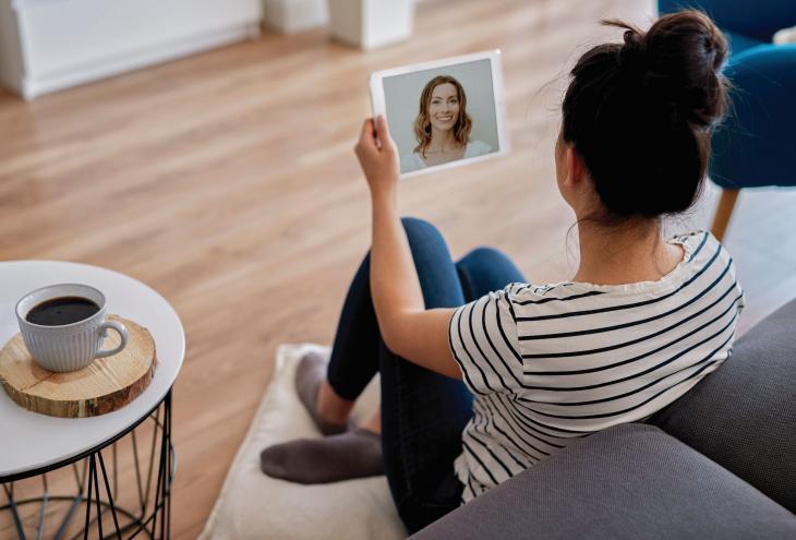 A woman using telehealth